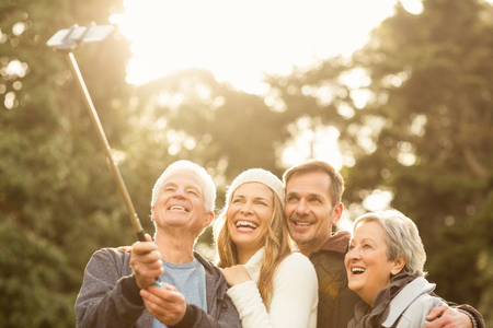 grandmother and grandson: Smiling small family taking selfies on an autumns day Stock Photo