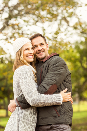 woman in love: Portrait of smiling young couple embracing on an autumns day Stock Photo
