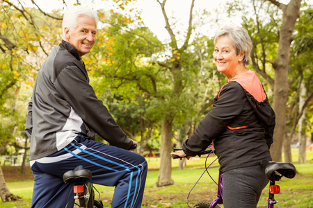senior exercise: Senior couple in the park on an autumns day