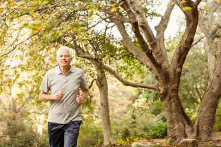 active senior: Senior man working out in park on an autumns day