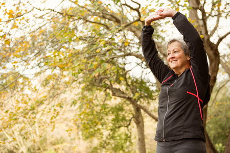 active senior: Senior woman in the park on an autumns day