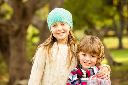 siblings: Happy siblings in the park on an autumns day