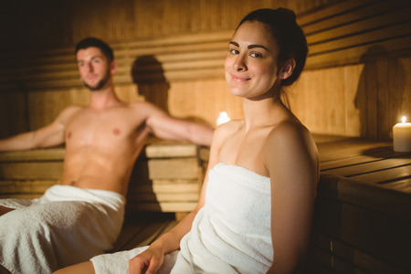 sauna: Happy couple enjoying the sauna together at the spa Stock Photo