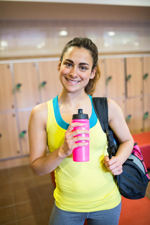 locker room: Smiling woman ready for a workout in the gym locker room