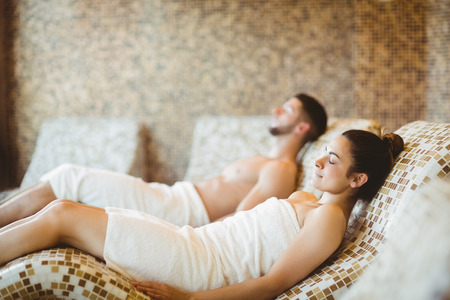 woman lying down: Man and woman lying down together at the spa