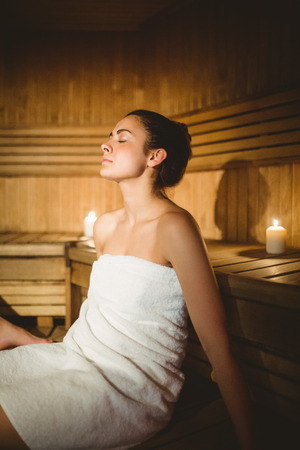 sauna: Happy woman enjoying the sauna at the spa