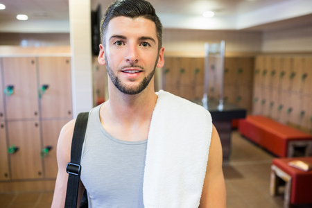 locker room: Smiling man about to go to the gym in the gym locker room