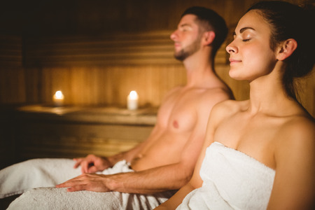 spa therapy: Happy couple enjoying the sauna together at the spa Stock Photo