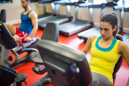 exercise machine: Woman using exercise machine at the gym
