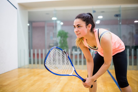 eager: Woman eager to play squash in the squash court Stock Photo