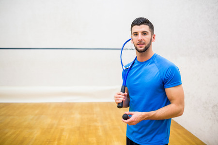 eager: Man eager to play some squash in the squash court