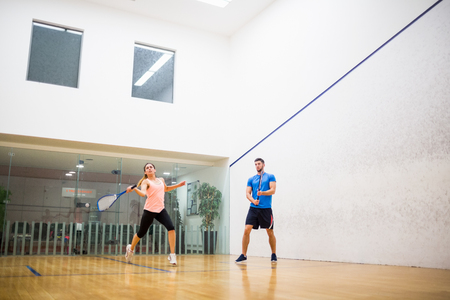 squash: Couple playing a game of squash in the squash court