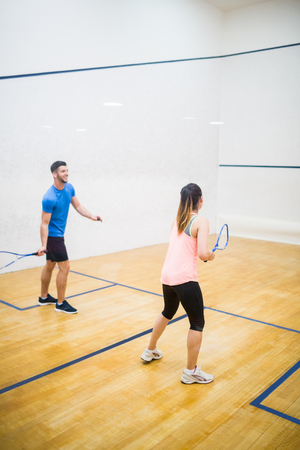 squash: Couple playing a game of squash  in the squash court Stock Photo
