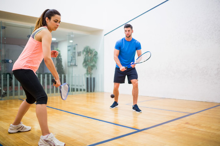 squash: Couple play some squash together in the squash court