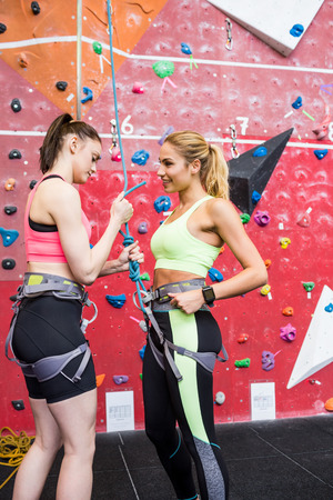 fit women: Fit women getting ready to rock climb at the gym Stock Photo