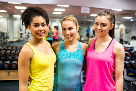 fit women: Fit women smiling at the camera at the gym