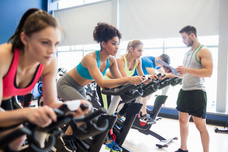 educator: Fit people in a spin class the gym Stock Photo