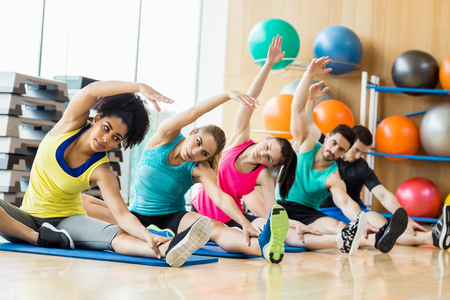 physical: Fitness class exercising in the studio at the gym