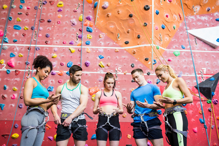 recreational climbing: Fit people getting ready to rock climb at the gym