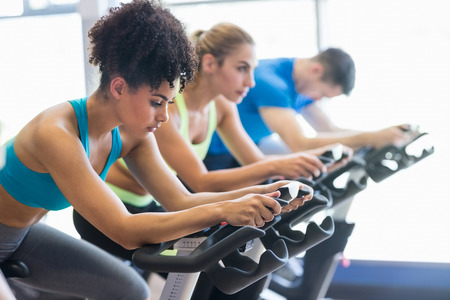 gym: Fit people in a spin class at the gym