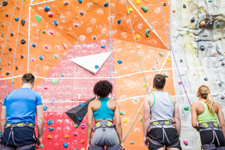 man climbing: Fit people ready to rock climb at the gym