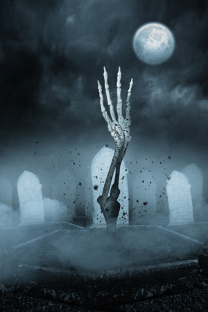 rising dead: Digitally generated Skeleton hand bursting from the grave