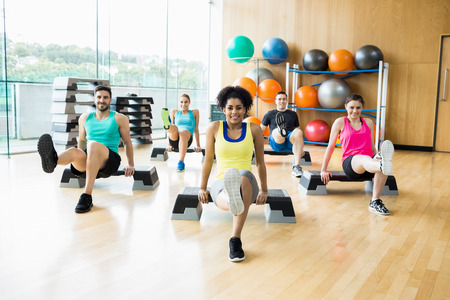 man exercise: Fitness class exercising in the studio at the gym