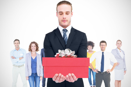 concentrated: Concentrated businessman holding out his hands against present