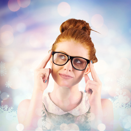 looking up: Hipster redhead looking up thinking against snowflake pattern Stock Photo