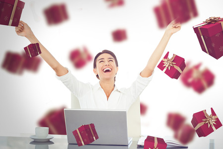 great success: Businesswoman celebrating a great success against red presents
