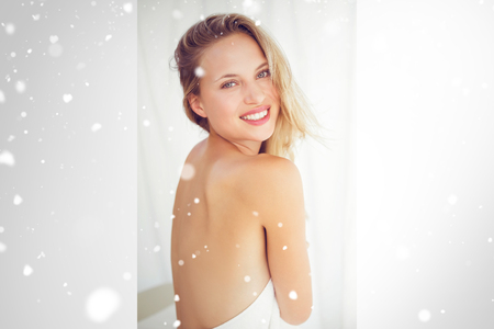 massage  table: Snow against pretty blonde sitting on massage table