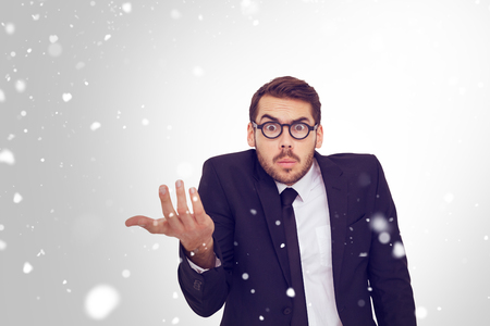 doubtful: Doubtful businessman with glasses gesturing against snow