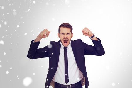 seins nus: Furious businessman tensing arms muscle  against snow Banque d'images