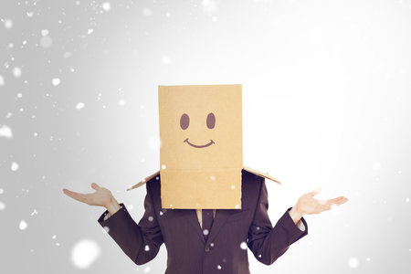 shrugging: Businessman shrugging with box on head  against snow