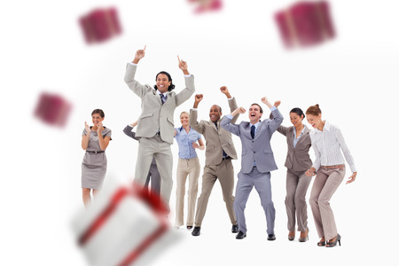 happy business team: Very enthusiast business people jumping and raising their arms against white and red gift box