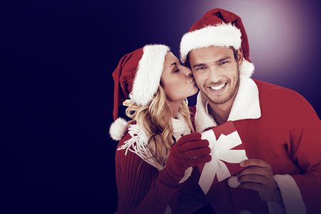 Young festive couple on dark background