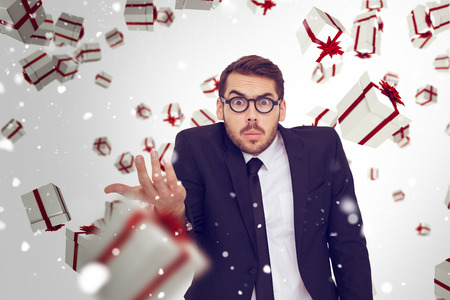 business skeptical: Doubtful businessman with glasses gesturing against snow