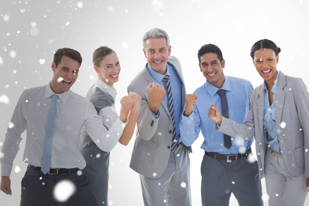 clenching: Portrait of successful business people clenching fists against snow