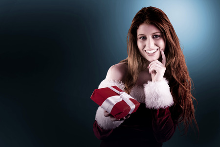 pere noel sexy: Festive redhead holding a gift on white background