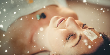 crystal healing: Snow against young woman at crystal healing session