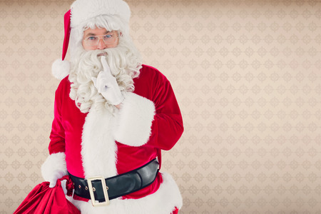 keeping room: Santa holding his sack and keeping a secret against room with wooden floor
