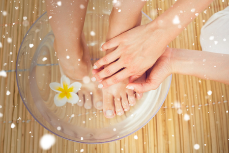 feet washing: Snow against woman washing her feet in a bowl of flower