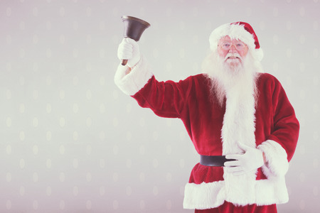 ring stand: Santa Claus rings his bell against room with wooden floor