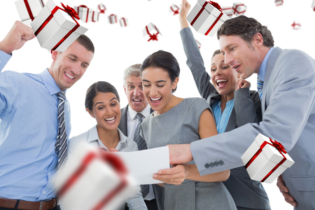 new contract: Business team celebrating a new contract against white and red gift box