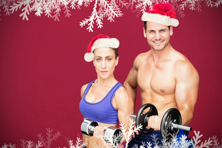 pere noel sexy: Bodybuilding couple against red background Banque d'images