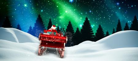 Vuelo de Santa en su trineo contra la brillante aurora sobre el bosque por la noche