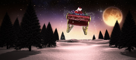 Santa flying his sleigh against full moon over snowy landscape
