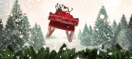 Santa flying his sleigh against christmas scene Stock Photo