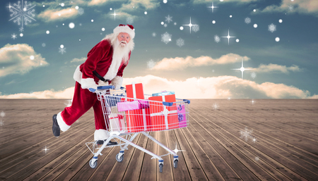 floorboards: Santa pushing shopping cart against wooden planks leading to blue sky Stock Photo