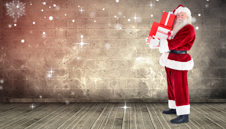 grimy: Santa carrying gifts against grimy room Stock Photo